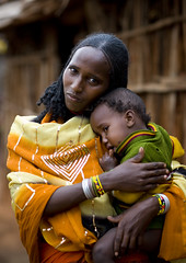 Diqoo, a Borana woman - El Dima Ethiopia (Eric Lafforgue) Tags: africa baby village artistic god african mother culture tribal explore mum ornament blackpeople bebe bodypainting tradition ethiopia tribe maman ethnic rite shaman tenderness tendresse sacrifice tribo indigenous dieu adornment tms africain afrique pigments indigenouspeople tribu omo eastafrica thiopien etiopia ethiopie etiopa tellmeastory etnia infanticide ethnique tribalgirl lafforgue  borana ethnie  ericlafforgue etipia 0676  southethiopia nomadicpeople ericlafforguecom  tribalgirls  abissnia   waqafatha eldima diqoo boranas bienvenuedansmatribu peoplesoftheomovalley