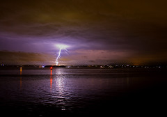 Natures power meeting man made power (ImageBud) Tags: longexposure light lake storm reflection night canon dark newcastle australia lightning thunder 40d blacksmithsbeach camdub