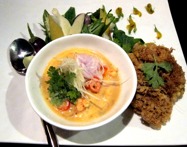 Lon gung jom naem duay kai fuu buu (Preserved fresh water prawn simmered in fresh coconut cream with lemongrass, white turmeric and chili served with deep-fried crispy egg and hand-picked crab meat)