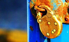 Government Lock (Doc macaSTAT) Tags: old gold interestingness poetry control minolta lock paddle rusty explore beercan jail copper imperial government alpha 7210 f4 hold symbolic corroded bind imprison detain plutocracy macastat