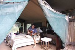 mike playing guitar in our safari tent
