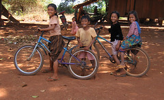 Beautiful, Smiling, Khmer Children (Mark Schraeger) Tags: sea cute beautiful smile smiling bicycle kids canon children asian asia cambodia southeastasia gorgeous banlung canonpowershots60 ratanakiri