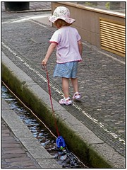 Hundstage  (Dog Days)  -  in Freiburg  (3) (pergi28) Tags: water germany toy kid child freiburg