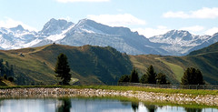 Reservoir on The Penken (crafteelady) Tags: snow mountains reflection austria tirol reservoir peaks mayrhofen penken