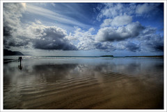 lonely (Janek Kloss) Tags: ocean blue ireland reflection beach strand island mirror photo foto fotograf view shot image photos surfer flag board hans eu surfing tourist an irland eire fotka atlantic loveit aisle end mayo fotografia 2008 reflexions achill attraction zdjecia irlanda kloss ierland keel janek j23 zdjecie fotki irlandia seson cuan mr wyspa   hwdp outstandingshots tr golddragon mywinners abigfave lirlande platinumphoto anawesomeshot fotosy  theunforgettablepictures goldstaraward trawmore  moli516 sandybank loveitalwayscommenton5