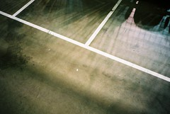 Velodrome shadows (knautia) Tags: uk england film manchester cycling october fuji shadows superia olympus ishootfilm xa2 olympusxa2 2008 velodrome 800iso trackcycling manchestervelodrome uciworldcupclassics trackworldcup xa2roll9 manchestercyclingweekend2008 manchestertrackworldcup2008