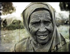 Somali Elder (LindsayStark) Tags: africa travel portrait people blackandwhite woman women war refugee conflict somali ethiopia elders humanrights humanitarian somalia displaced humanitarianaid emergencyrelief postconflict waraffected conflictaffected overtheexcellence goldstaraward