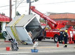 Los Angeles Firefighters upright an overturned cargo truck. © Photo by Mike Meadows. Click to view more...