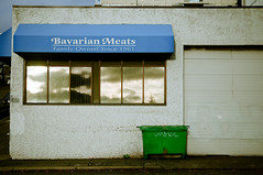 bavarian meats (poopoorama) Tags: seattle reflection building window dumpster washington store nikon sigma d300 1850mmf28exmacrohsm