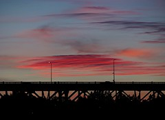 As evening comes (GustavoG) Tags: seattle camera bridge red sky cloud lamp evening traffic dusk lamppost aurora flaming enlightedbridge