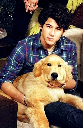 Nick Jonas and Elvis the dog by NAT TAS TIC.