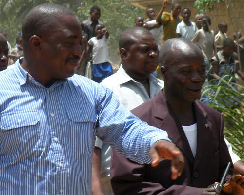 Kabila and Somba walk through town