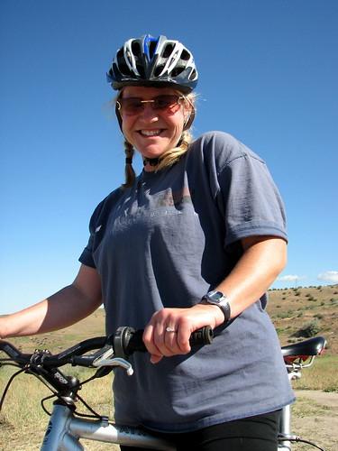 Still straddling her bike