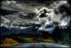 After the rain (pravin_mahtani) Tags: road newzealand sky nature rain clouds nz southisland milford fiordlands