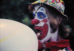 Balloons clown in Washington square NYC (NaPix -- (Time out)) Tags: nyc portrait film balloons nikon clown ishootfilm washingtonsquare 70s agfachrome visiongroup napix alightheartedpoem