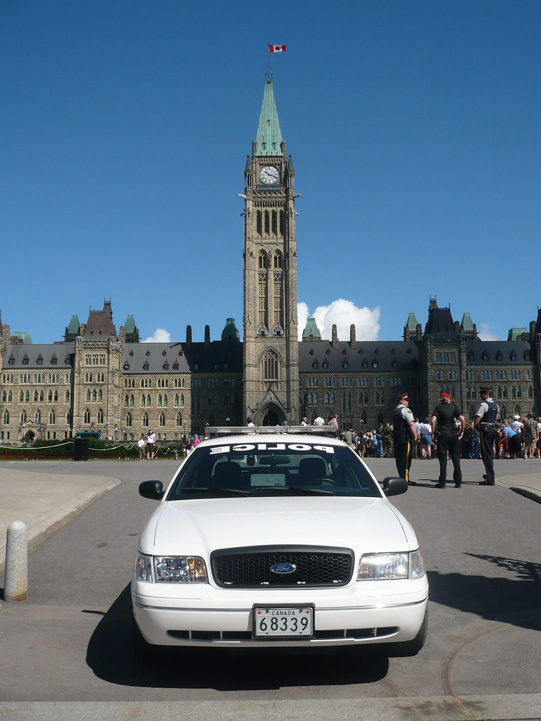 A Canadian Forces Ford Crown Victoria Military Police car and the Peace Tower.