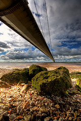 Under the Bridge (Esther Seijmonsbergen) Tags: bridge beach water composition river photography junk nikon rocks exposure shoreline estuary shore esther suspensionbridge hdr decayed humberbridge humber foreground leadinglines leadingline digitl leadinline leadinlines foregroundinterest goodredroad estherseijmonsbergen wwwdigitalexposurephotographycom