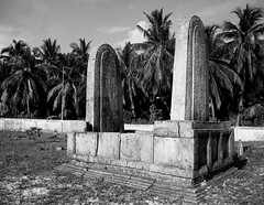 Entombed (mohlat) Tags: old travel blackandwhite bw history monument nature cemetery grave graveyard dead island photography death photo amazing interesting ancient community flickr respect natural image god muslim famous headstone tomb picture culture casket kingdom ground funeral human photograph um gravestone burial historical ritual sultan tradition corpse custom past monarchy remnants touristattractions islamic norm entombed afterlife royals atoll deceased addu maldivian canoneos300ddigital stonemarker interment dhivehiraajje ghiyasuddin coconutpalmtrees addoo uniquemaldives mohlat gaburusthaan smeedhoo mohamedlatheef koagannu thetombofkoagannu mahaanagaa kingghiyasuddin oldestcemetryinthemaldives