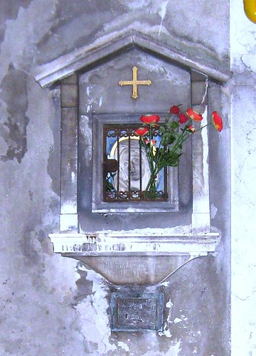 madonna shrine red flowers