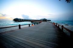 Water Villas at dusk (edwardkb) Tags: sunset cloud water pier honeymoon indianocean bluesky promenade maldives beachhouse clearwater ruvjet manafaru edwardbarnieh oceanvilla grandoceanpavilion