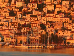 Poros waterfront at sunset (Marite2007) Tags: travel houses sunset red sunlight color colour tourism water closeup architecture boats islands harbor seaside holidays colorful europe harbour outdoor aegean facades location greece seashore ports saronic poros