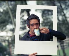 Polaroid de locura ordinaria 3 (RubioBuitrago) Tags: boy portrait guy 120 mamiya film coffee mediumformat polaroid cafe colombia bogo