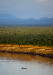 Sunset on Omo River Ethiopia (Eric Lafforgue) Tags: africa river boats artistic african tribal ornament blackpeople bodypainting ethiopia tribe ethnic rite tribo adornment africain afrique pigments tribu omo eastafrica thiopien etiopia ethiopie etiopa ethnique 5491 lafforgue  etiopija ethnie ethiopi  ericlafforgue etiopien etipia  etiyopya  southethiopia nomadicpeople ericlafforguecom    abissnia      gibeiiidam bienvenuedansmatribu peoplesoftheomovalley
