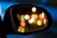 Mirror lights (©Komatoes) Tags: light car night 50mm lights mirror nikon bokeh wing balls devon nightlight f18 torquay 50mmf18 d40 mirrorbokeh mirrorlights carmirrorlights nightlightsoncarmirror mirrorcolouredlights