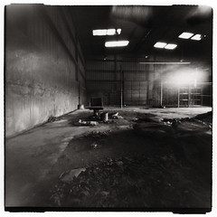 Chair, alone in a warehouse (Otto K.) Tags: atlanta bw abandoned 6x6 film mediumformat blackwhite holga chair industrial center pinhole squareformat deserted decayed recyclingcenter pinholga darkroomprint ottok rolleiretrofilm agfarodinaldeveloper