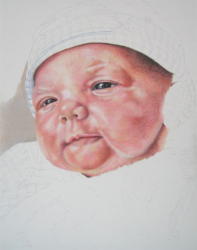 In progress photo of colored pencil portrait entitled Emre, Newborn