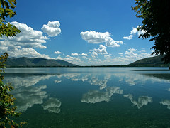 reflections (nicolas.gr) Tags: blue trees sky mountain lake clouds reflections perfect photographer photobook greece macedonia nicolas soe the kastoria blueribbonwinner supershot mywinners abigfave platinumphoto lezas ultimateshot diamondclassphotographer flickrdiamond ysplix picturefantastic theperfectphotographer goldstaraward flickrlovers nicolasgr