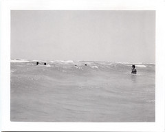 out in the waves.... (davidteter) Tags: bw film beach gulfofmexico polaroid surf texas padreisland expiredfilm polaroid664 polaroid110a 14hrsofswimming stream:timeline=linear