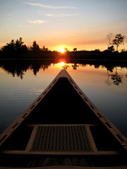Canoeing at Sundown (cedarkayak) Tags: statepark sunset reflection dusk michigan explore canoeing soe baldmountain stillwaters woodboat cedarstripcanoe grahamlake cedarkayak caneseat