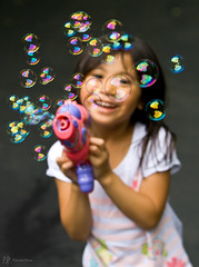 Fun With Bubbles (-JC-) Tags: girl kids canon children adobephotoshop dof child bokeh bubbles depthoffield canon70200mmf28lisusm adobelightroom canondigitalrebelxti aplusphoto onlythebestare clevercreativecaptures canon70200lf28