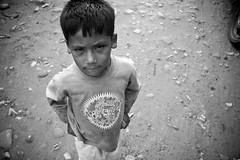 Boy on road (rex dart: eskimo spy) Tags: nepal boy portrait people bw digital canon20d documentary international wwwlanguagelesscom goldhunga