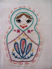 Russian Doll close (Brook...) Tags: baby elephant tattoo vespa handmade embroidery political eiffeltower donkey diadelosmuertos sublimestitching etsy embroidered onesie russiannestingdoll stitchedbyhand
