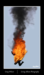 Man on fire jumps for his life. (Craig Wilson Photography) Tags: show sky man male fall real fire person climb flying jump smoke flames drop falling torch shock diver annual stunt fallingdown dpa s5800 scottbrewer lotans