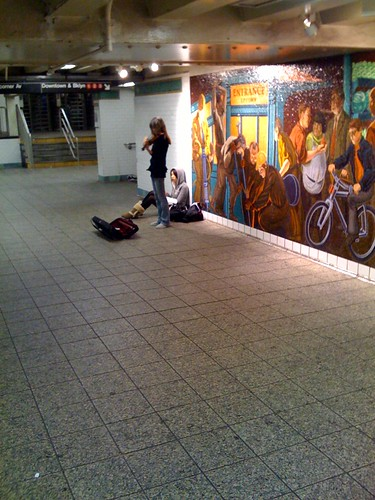 Girl playing violin in the subway