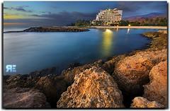 Hotel Star Light (Ryan Eng) Tags: ocean longexposure sunset sea beach water hawaii hotel sand rocks nightshot oahu explore dri photoshopcs2 koolina slowshutterspeed waianae kapolei digitalblending sigma1020 nikond90 ryaneng ryausting manmadecoves