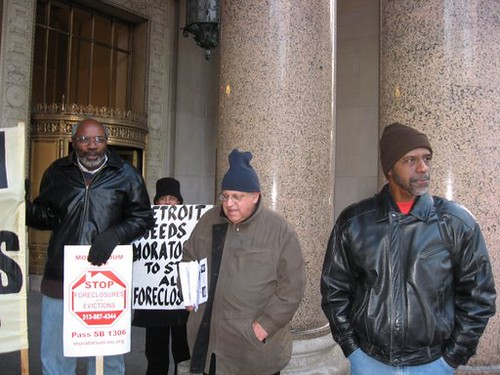 Abayomi Azikiwe, editor of the Pan-African News Wire, covering a Moratorium Now! Coalition demonstration outside the State Office Building, Cadillac Plaza, in the Detroit New Center Area on November 20, 2008. (Photo: Alan Pollock). by Pan-African News Wire File Photos