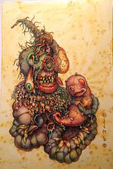 lullaby (ojimbo) Tags: baby love monster daddy snuggle hug outsider surreal creepy anatomy gore cutebaby guardian lowbrow guts bizzare ojimbo