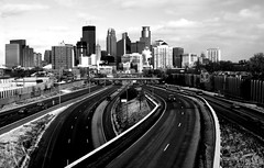 Minneapolis Skyline (Chris Coward Photography) Tags: road city winter urban blackandwhite snow minnesota skyline clouds contrast highway minneapolis freeway interstate twincities blackdiamond minneapolisskyline sigma28300mmf3563dgmacro canondigitalrebelxti true2bw spiritofphotography blackdiamondpremier