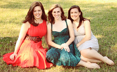 Lovely Ladies (Casey David) Tags: girls red portrait woman brown black green smile grass smiling portraits pose hair out outside outdoors belt frames spring women dof dress purple bokeh outdoor formal graduation posed blowing depthoffield framing bsc birminghamsouthern