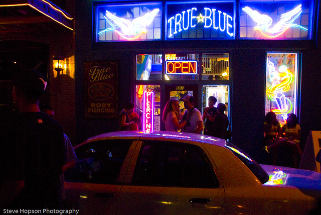 The True Blue tattoo parlour in Austin Texas, open during the nighttime