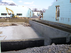 the concrete base for the competition pool is completed