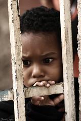 Mirada (125/365) (Daniel Lopez Fotografa Venezuela) Tags: portrait face look canon sadness tristeza child sad expression retrato venezuela cara poor caracas 70300mm mirada nio barrio pobreza petare expresin daniellpez daniellopez dramaticportrait rebelxti canoneosrebelxti aplusphoto canonef70300mm niopobre
