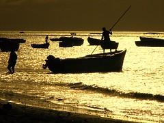 Going fishing (Asadbabil (super busy)) Tags: ocean sunset sea sky sun beach nature clouds canon boats boat blueocean finshing aplusphoto poseidonsdance