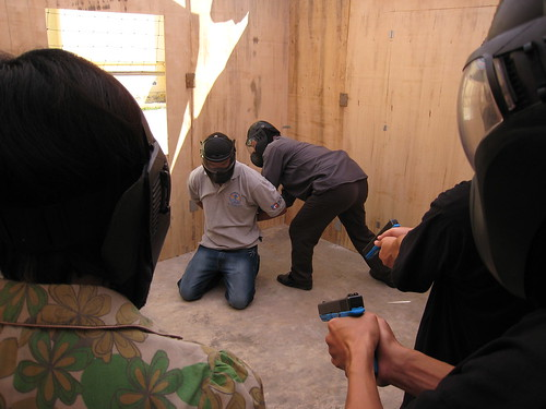 A Vietnamese counter-narcotics officer handcuffs an American playing the role of a drug offender during DEA training exercises. Hanoi, July 30, 2008.