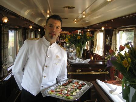 Wagons Lits carriage now a piano bar - steward offers canapés