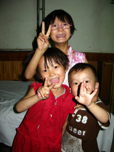 Enthusiastic kids of inn owner in Minhe, Gansu Province, China